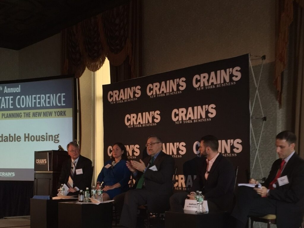 REBNY President Steve Spinola (center) with other panelists